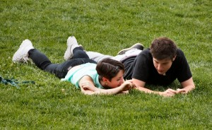 Couple practicing relationship communication in the grass